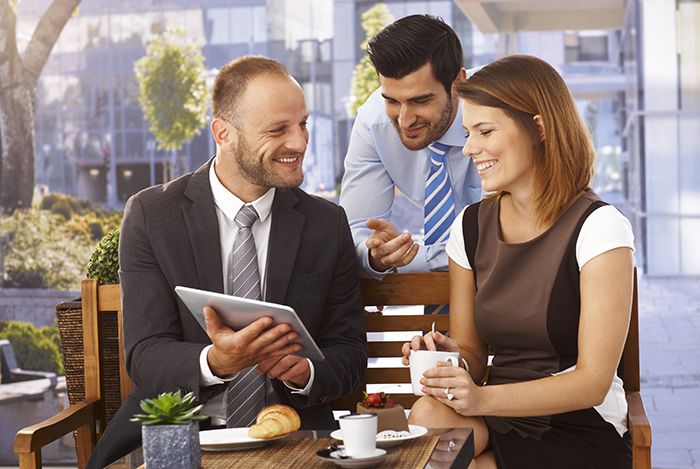 Couple and waiter with digital tablet