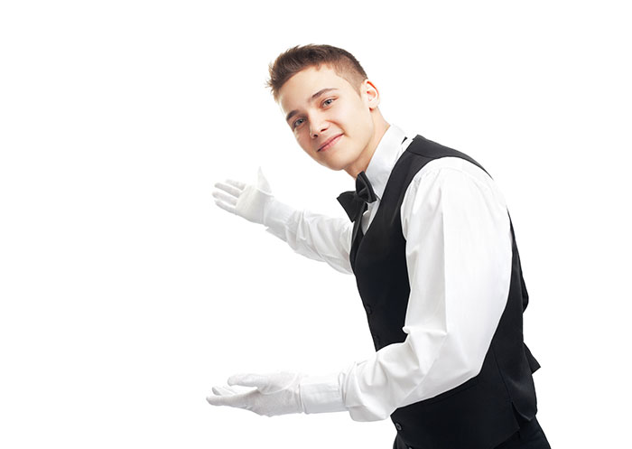 Waiter in white gloves